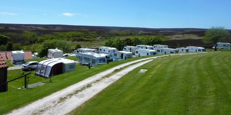Sunshine on some tourers at Grouse Hill