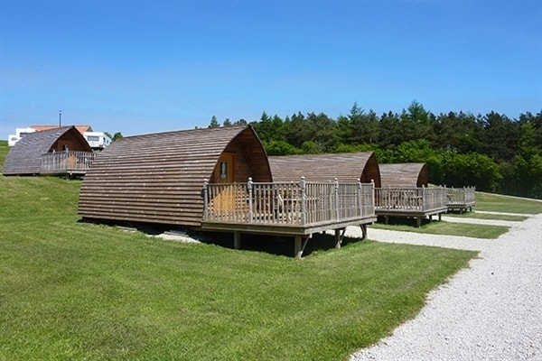 Relax in our heated wooden Wigwam® Cabins