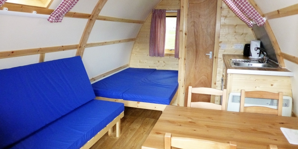 Wigwam® Cabin interior including comfy mattresses